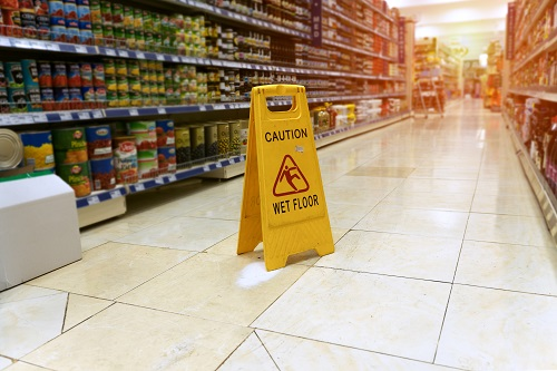 wet floor sign at store selling food